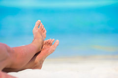 Close up of female feet on white sandy beach Royalty Free Stock Photo