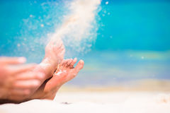Close up of female feet on white sandy beach Stock Image