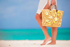 Close up of female feet on white sandy beach Royalty Free Stock Image
