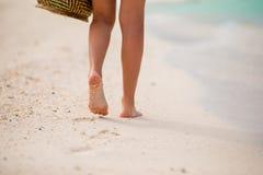 Close up of female feet on white sandy beach Royalty Free Stock Photo