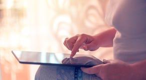 Close up of female finger pushing digital tablet touch screen. Close up of female hand and finger pushing digital tablet touch screen. Woman using modern Stock Photos