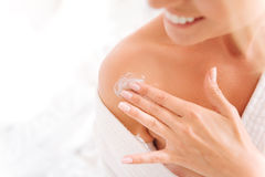 Close up of female fingers that applying lotion stock photo