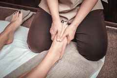 Close up of a female foot being massaged. Best pleasure. Close up of a female foot being massaged by a professional female massage therapist royalty free stock images