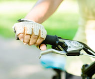 Close up female hand on bicycle handlebar Royalty Free Stock Photography
