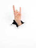 Female hand, horns gesture, paper with hole Stock Photo