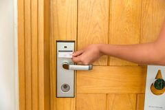 Close up of female hand hold key card and open electronic lock door stock images