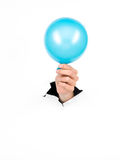 Female hand holding blue balloon Stock Photo