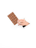 Female hand holding delicious chocolate bar Royalty Free Stock Image