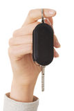 Close up on female hand holding a car key Stock Photo