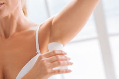 Close up of female hand that holding deodorant stick royalty free stock photos