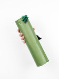 Female hand holding a green gift box Royalty Free Stock Photography