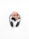 Girl hand holding black headphones Royalty Free Stock Images
