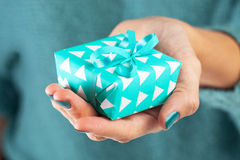 Close-up of female hand holding a present Stock Photography