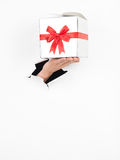 Female hand holding a present Stock Photography