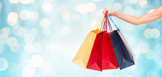 Close up of female hand holding shopping bags Stock Photography