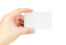 Close up Female hand holding white blank business card isolated Royalty Free Stock Image