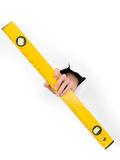 Hand holding a spirit level through white paper Royalty Free Stock Images