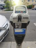 Close up of female hand inserting credit card into parking meter stock photography