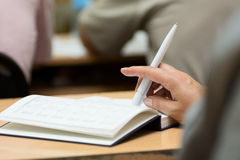 Close-up of a female hand with a pen Stock Photos
