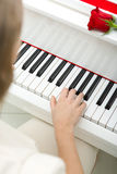 Close up of female hand playing piano Stock Photos
