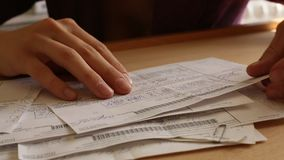 Close-up: Female hand thumb through billing accounts (HD) stock footage