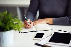 Female hand writing in diary Royalty Free Stock Images