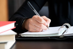 Close up Female hand writing notes Royalty Free Stock Photography