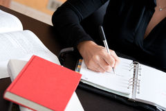 Close up Female hand writing notes Stock Photos