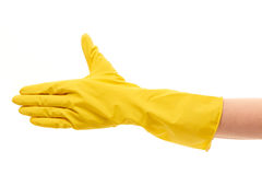 Close up of female hand in yellow protective rubber glove giving for handshake. Against white background Royalty Free Stock Image