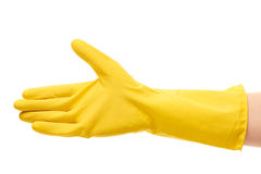 Close up of female hand in yellow protective rubber glove giving for handshake. Against white background Stock Photos
