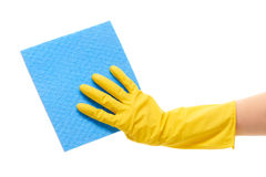 Close up of female hand in yellow protective rubber glove holding blue rag Stock Image
