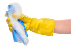 Close up of female hand in yellow protective rubber glove holding blue rag in foam Stock Images