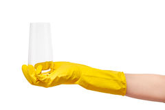Close up of female hand in yellow protective rubber glove holding clean transparent drinking glass Royalty Free Stock Photography