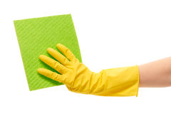 Close up of female hand in yellow protective rubber glove holding green rag Royalty Free Stock Image