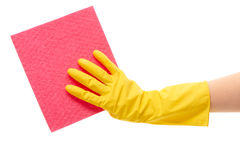 Close up of female hand in yellow protective rubber glove holding pink rag Royalty Free Stock Photos
