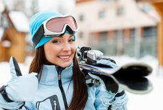 Close up of female handing skis who thumbs up Royalty Free Stock Images