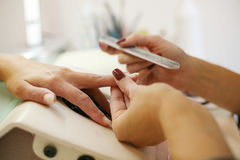 Close-up of female hands being manicured. Stock Photography