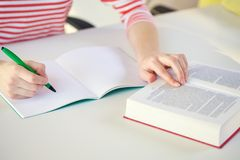 Close up of female hands with book and notebook Stock Photos