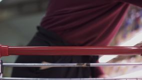 Close-up of female hands on cart in supermarket. Slow motion. stock footage