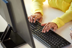 Close up of female hands with computer typing Stock Photos