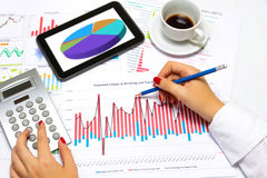 Close up of a female hands, doing business statistics, at office desk. Stock Images