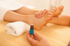 Close-up of female hands doing foot massage Stock Images