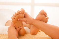 Close-up of female hands doing foot massage Stock Image