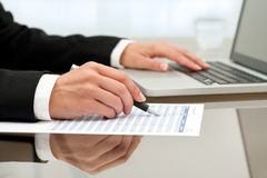 Close up of female hands doing paperwork. Royalty Free Stock Photography