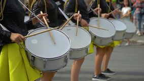 Ternopil, Ukraine June 27, 2019: Close-up of female hands drummers are knocking in the drum of their sticks. Close-up of female hands drummers are knocking in stock footage