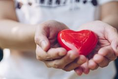 Close up female hands giving red heart on hands.  royalty free stock images