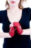 Close-up of female hands in gloves. Close-up of female hands in red leather gloves Royalty Free Stock Photos