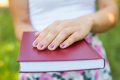 Close up female hands holding a book Stock Images