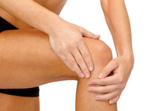 Close up of female hands holding knee Royalty Free Stock Photos
