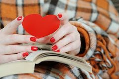 Close up of female hands holding red heart. Close up of female hands holding red heart stock photo